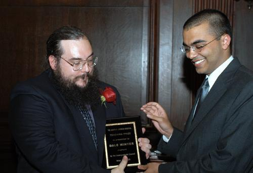 Undergraduate Council President ROHIT CHOPRA '04 gives Mathematics preceptor DALE WINTER the Levenson Memorial Teaching Award at a celebratory dinner in Eliot House dining hall Wednesday night.