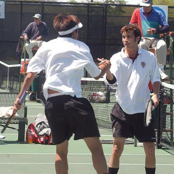 Sophomore JONATHAN CHU (left) and junior co-captain DAVID LINGMAN celebrate a point during their 9-7 win at No. 1 doubles against Virginia Commonwealth on Saturday.