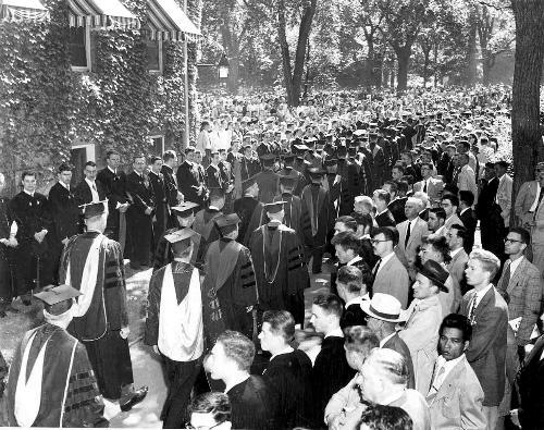 Graduates of the Class of 1953 process into the Yard during Commencement exercises after a spring filled with friends shipped off to Korea and scandal over accusations of communists at Harvard.