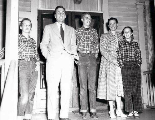 NATHAN M. PUSEY '28, with his wife and three children, stands on his porch in Appleton, Wis., shortly after being selected to be Harvard's 24th president.