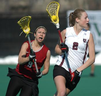 Sophomore BESSIE CLARK (left) of the women's lax team protects thd ball from a defender. Tri-captain DOUG LOGIGIAN (right) was a second team All-Ivy selection and a force on attack.