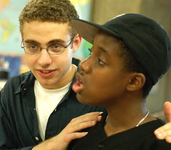 ADAM ZALISK '07 speaks with student HERBY JOLIMEAU, a rising seventh grader. The Summerbridge program offers training in a variety of academic pursuits and life skills.
