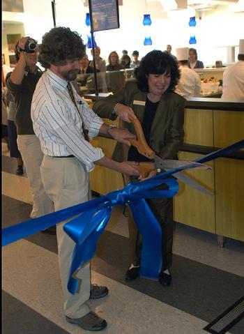 HUDS officials perform the celebratory ribbon-cutting yesterday to usher in a newly renovated Greenhouse Cafe in the Science Center