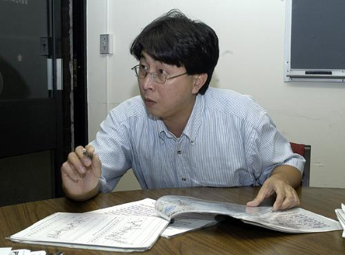 WILLIE SOON, a Harvard scientist and the author of a controversial study denying that there has been global warming in the 20th century, shows data defending his research yesterday.