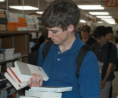 SCOTT M .RICHARDSON '07 looks for books at the Coop.