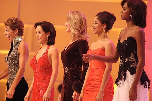 LAURIE B. GRAY '03 (second from left) and NANCY A. REDD '03 (second from right) line up to hear the top five finalists for the Miss America Competition 2003.  Though they did not place among the top five, each won one of the preliminary events.