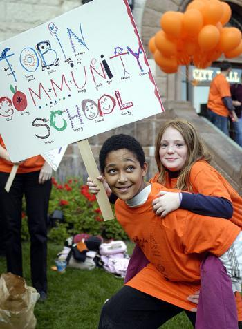 Cambridge students MICHAEL PETERSON (left) and SYDNEY AGGER enjoy a rally held at City Hall yesterday afternoon in support of afterschool programs.