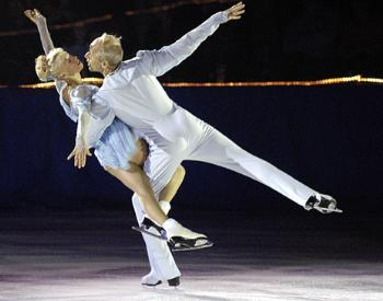 OLEG and LUDMILLA PROTOPOPOV, 1964 and 1968 Olympic gold medalists, skate their 14th performance at the Bright Hockey Center during Eliot House's annual Evening With Champions.