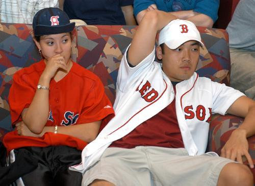 Despair settles over the Quincy House Junior Common Room as LESLEY M. CHIN '04 and JAMES LI '05 see the Red Sox fall to the Yankees in a tense, extra-innings close to the American League championship series.