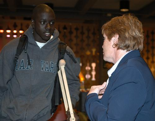 KWAME OWUSU-KESSE '06 speaks with an FBI Special Agent, who would not release her name, during a job fair sponsored by the Black Men's Forum in Loker Commons yesterday.