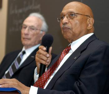 HERBERT H. HEILBRUN, left, and JOHN M. LEAHR speak during a lunch in their honor hosted by the Harvard Foundation for Intercultural and Race Relations. The two were third-grade classmates, reunited decades later.