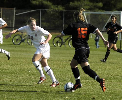 Despite freshman LAURA ODORCYK (28) and the rest of the Crimson defense's best efforts, Princeton's MAURA GALLAGHER (15) scored the equalizer in the 70th minute of teh teams' 1-1 tie on Saturday.