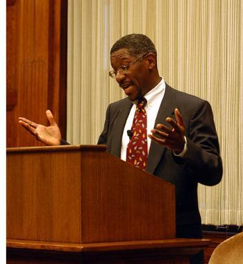 GERARD L. EARLY, a professor at Washington University in St. Louis, speaks about race in sports at the Barker Center last night.
