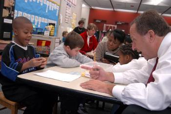 University President LAWRENCE H. SUMMERS gives a first-grader a math lesson as principal for the day of Allston's Jackson-Mann Elementary School.