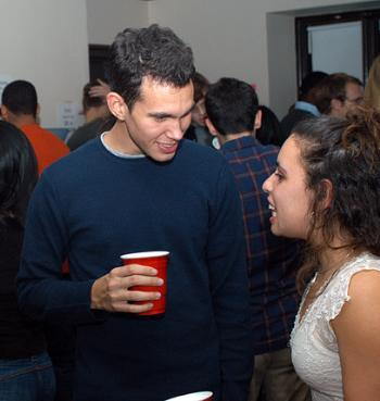 KYLE E. SCHERER '05 drops the H-Bomb on a Tufts student at a Undergraduate Council-funded party Saturday night in Adams House. The Council will continue to fund parties throughout the semester.