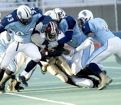 Freshman tailback CLIFTON DAWSON, along with the rest of the Harvard offense, was shut down by the Columbia defense in the second half of Saturday's 16-13 upset loss. The Crimson gained just 262 yards of offense, half its usual output.