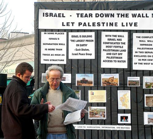 SHERIF FAN, right, a Cambridge resident and member of the group BostonToPalestine, protests Israels proposed security fence in the West Bank yesterday. The protest was unrelated to the appearance of prominent Israeli journalist Yossi Klein Halevi, wh