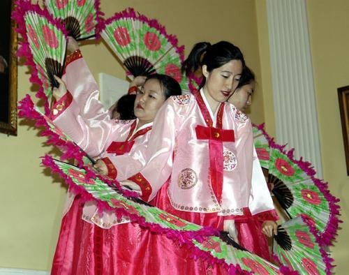 The Chunsa Dance Troupe performs a traditional Korean fan dance at the Cultural Extravaganza in Lowell Dining Hall Friday.