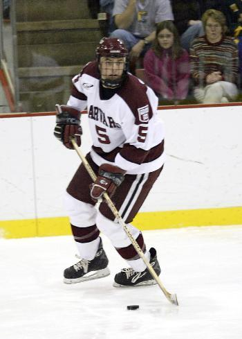 Junior defensemen NOAH WELCH, shown here in earlier action against Clarkson, leads Harvard's defensemen with six points.