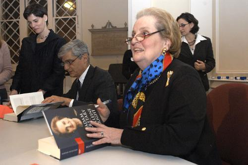 Former Clinton cabinet members Madeleine K. Albright and Robert E. Rubin '60 sign copies of their new books at the First Parish Church Monday night.