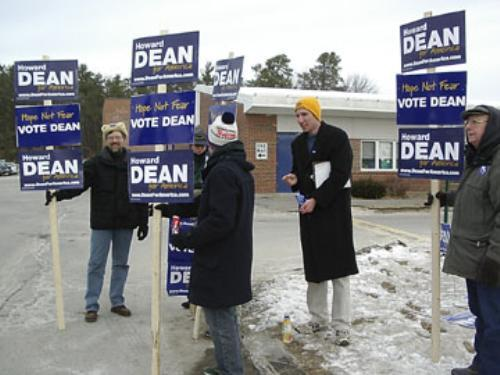 Gregory M. Schmidt '06, second from right, campaigns for Dean outside a Nashua, N.H., school.
