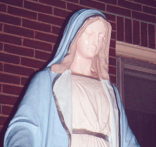 Some area residents believe this statue of the Virgin Mary, outside Medford's Sacred Heart Church, has been crying since Feb. 9.