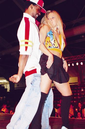 Two students dance at the Eleganza fashion show on Friday night.