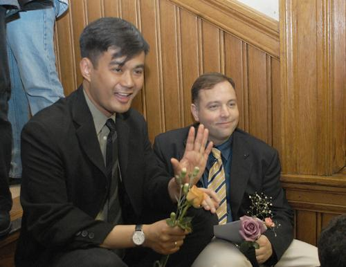 Bren Bataclan, left, waits with his partner Bob L. Parlin '85 for a marriage license at City Hall. The couple was the first same-sex couple to have a commitment ceremony in Memorial Church in 1998.