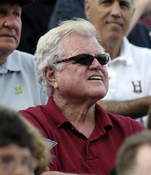 Kennedy keeps his eye on the ball at a Harvard-Dartmouth football game.
