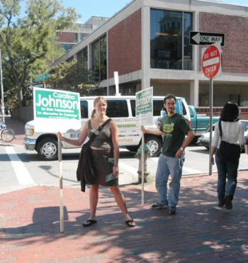 Carolina S. Johnson '04, left, who ran unopposed in yesterday's Green Party primary for State Representative in the 25th Middlesex District, campaigns outside Quincy House yesterday alongside Benjamin M. Goldman-Huertas '05.
