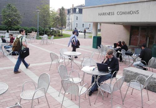 Law School students come and go from the newly-renovated Harkness Commons, their social space equivalent to Loker Commons, yesterday afternoon. Summertime renovations included an expanded lounge and new furniture.