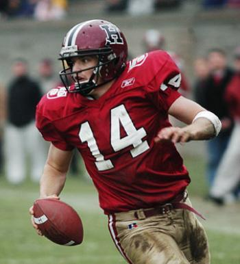 Ryan Fitzpatrick, the 121st captain of the Harvard football team, scrambles around the pass rush.
