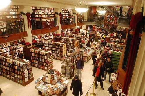 With five days left until Christmas, holiday shoppers browse the Coop yesterday looking for gifts among crowded bookshelves topped with festive decorations such as poinsettias and wreathes.