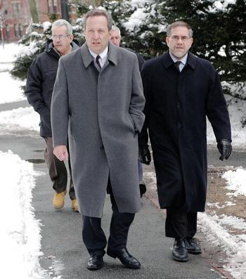 University President Lawrence H. Summers, left, and Provost Steven E. Hyman walk through Harvard Yard yesterday afternoon on the way to the Faculty meeting at Lowell Lecture Hall.