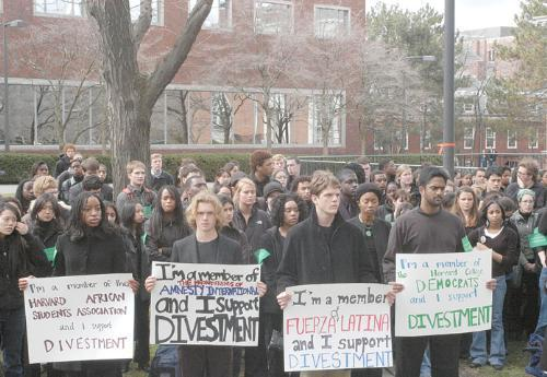 Chimnomso K. S. Kalu '07, Alexander D. Rafael '07, Felipe A. Tewes '06, and Vikram Viswanathan '06, along with 150 other students walked to Loeb House yesterday in a silent protest organized by the United Front for Divestment.