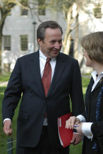 University President Lawrence H. Summers chats with faculty as he leaves a Faculty meeting in University Hall yesterday.