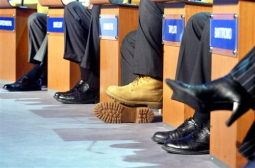 The footwear of several panelists is seen at last year's meeting of the World Economic Forum in Davos, Switzerland. At center, in Timberland boots, University President Lawrence H. Summers, is prepared for the snow and freezing temperatures in Davos.<b