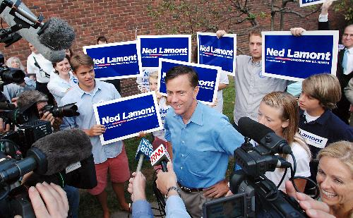 Senate hopeful Ned Lamont '76 speaks to reporters outside of Greenwich High School in Greenwich, Conn. today, before voting in the Democratic state primary.