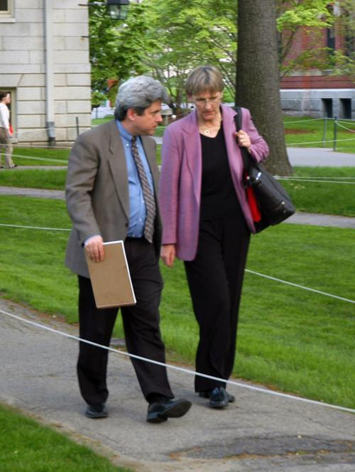 University President-elect Drew G. Faust walks with Secretary to the University Marc L. Goodheart '81 toward Mass. Hall after professors voted to approve a new general education curriculum for the College.
