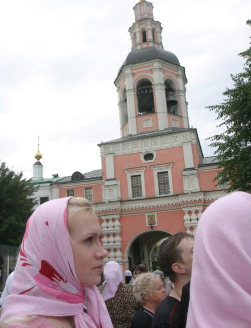Crowds of worshippers watch the consecration of Lowell House's new bells in Moscow on Tuesday. The Danilov Monastery's belltower, the past and future home of the 17 bells that have hung in Lowell since 1930, is in the background.