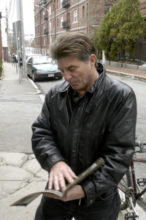 Poet Populist Peter Payack can often be spotted wearing a black leather jacket as he zips down Mass Ave on bike.