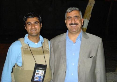 Junaid M. Munir, a Harvard Law School graduate, poses with Anbar Provincial Council Chairman Abdusalam Abdullah. Munir served as his liaison officer.