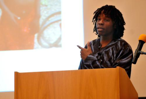 "David M. Sengeh '10 discusses his experience distributing insecticide-treated mosquito nets to battle malaria in Sierra Leone at Friday's ""Stand Up & Take Action Against Poverty"" rally. Students from throughout the Boston area gathered to reaffirm the Mil"