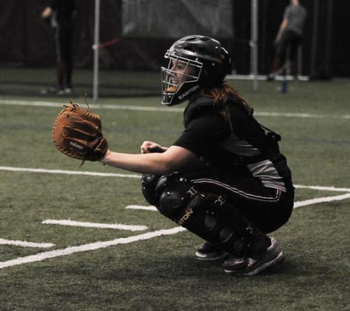 As the team's four-year starting catcher, co-captain Hayley Bock provides a more vocal leadership role as the primary on-field signal caller.
