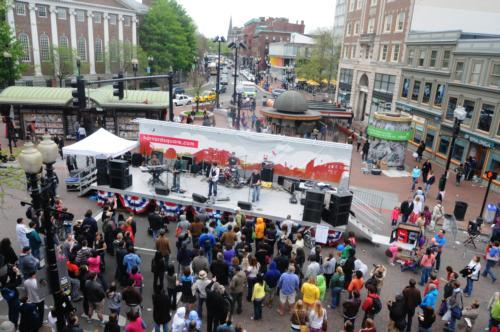 Musical artists perform for the crowds in Harvard Square for Mayfair as vendors and craftsmen line the streets showing their products..