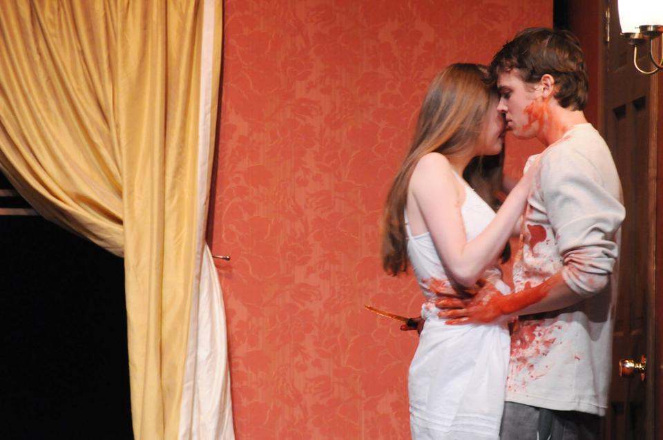 """Orestes (Jack Cutmore-Scott '10) and Electra (Carolyn Holding '10) embrace after the murder of their mother, Clytemenstra (Tali Friedman '10) and stepfather, Aegistheus (Chris Carothers '11). """"The Flies,"""" directed by Geordie F. Broadwater '04, will run on the Loeb Mainstage until Oct. 24."""