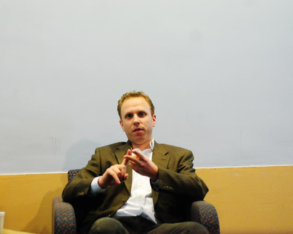 """Max Blumenthal speaks in Quincy use Junior Common room Sunday night about concerns and issues related to his book """"Republican Gomorrah""""."""