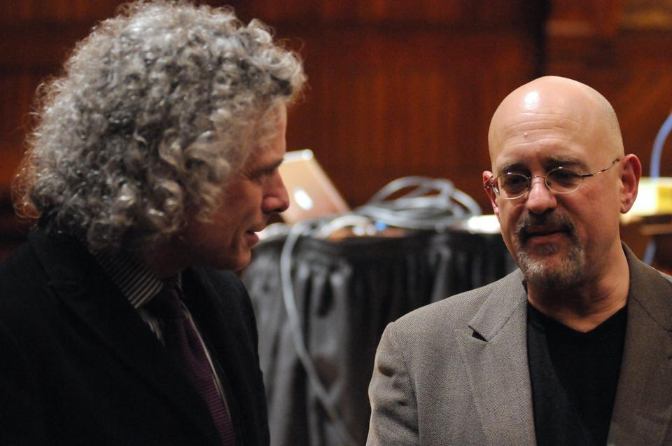 Professors Steven Pinker and Daniel Gilbert chat during intermission yesterday at Harvard Thinks Big.