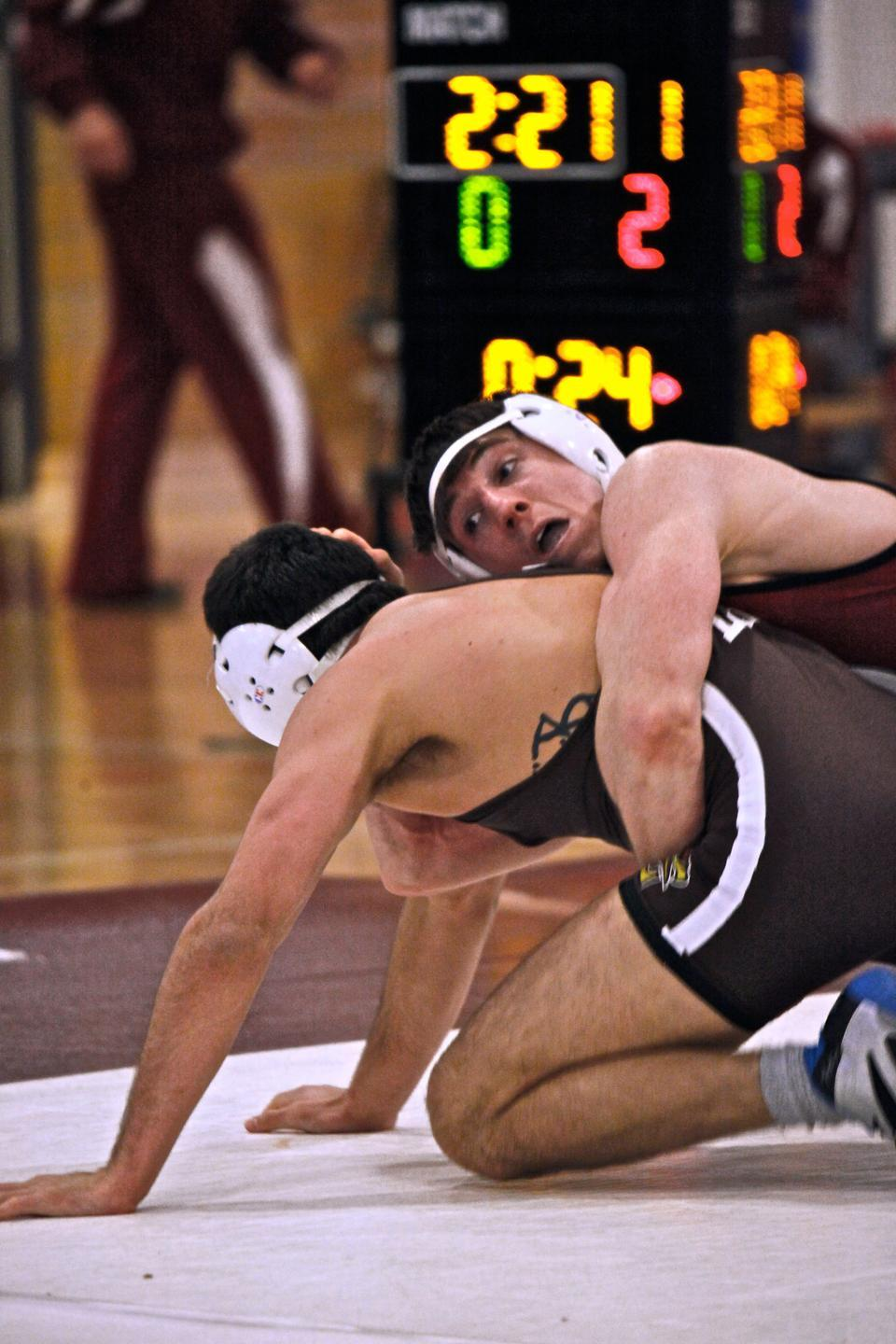 Crimson wrestling co-captain J.P. O'Connor, shown here in earlier action, captured the national title at 157 lbs. The Harvard star joined Jesse Jantzen '04 and John Harkness '38 as the only Crimson competitors to win a championship.