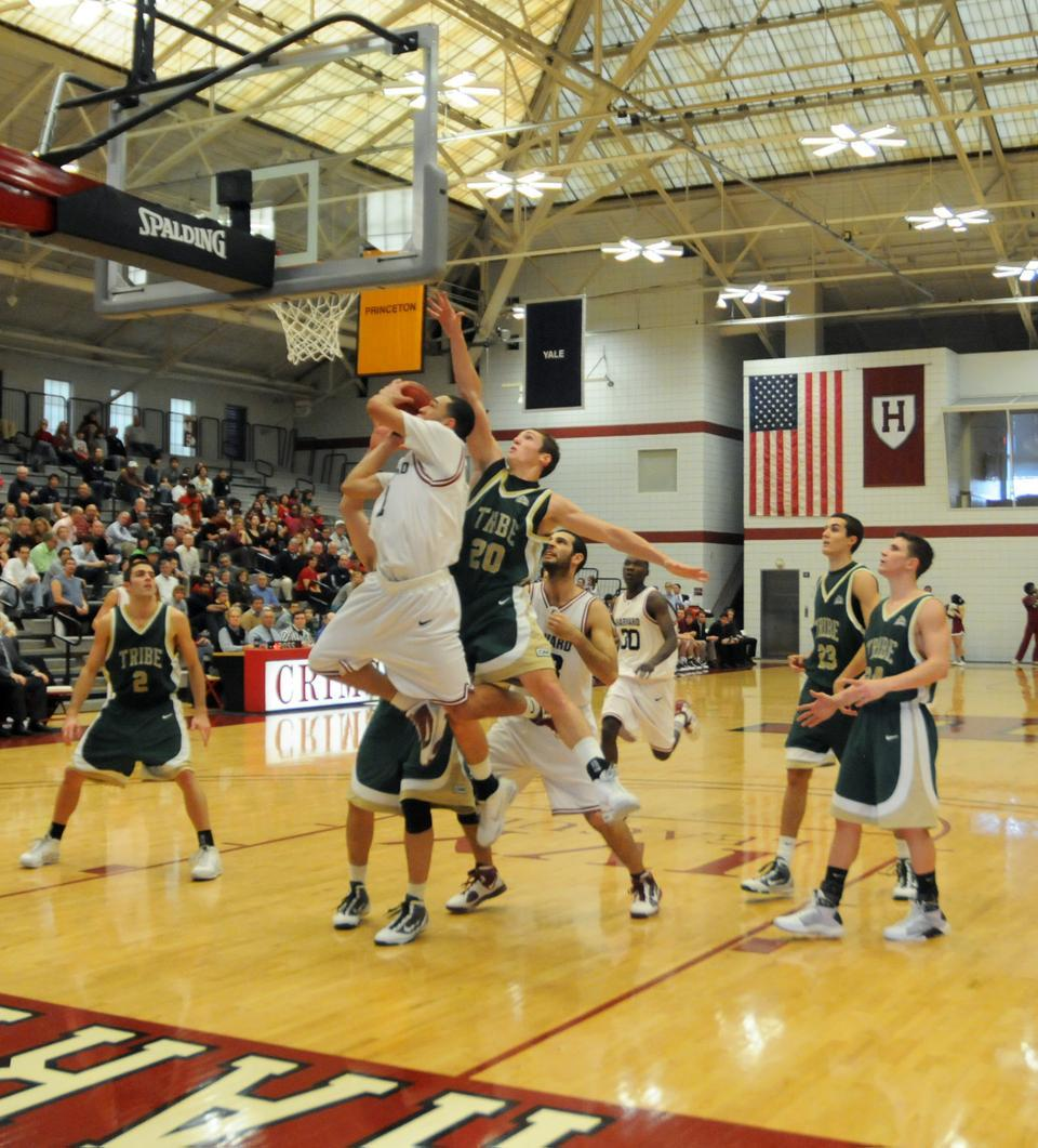 Freshman Christian Webster elevates to the basket as he is contested by William and Mary's Quinn McDowell during Harvard's triple-overtime victory over the Tribe in the Crimson's second game of the season.